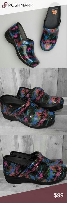 Dansko XP Color Pop Patent Clogs 41 Beautiful glossy patent leather Dansko XP paint splatter/swirl clogs. Padded insole with non slip grips on the bottom. Worn only a couple times they are in as close to New condition as possible. Blues, pink, black, green and more. Perfect for nurses, vets, doctors, teachers or anyone on their feet all day!!    EU 41 or US 11   No trades Dansko Shoes Mules & Clogs