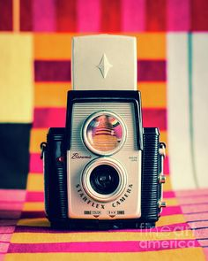 Still life photo of vintage camera by Sonja Quintero of Squint Photography.