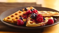 This classic waffle recipe topped with fresh berries makes breakfast a special occasion.