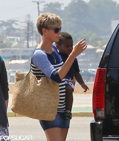 Charlize Theron held on to little Jackson in LA