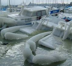 Frozen shipwreck. Europe.  Unusual weather for this region.. financial devastation was immense