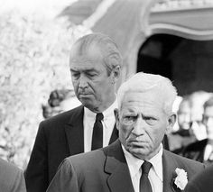 Mourners James Stewart and Spencer Tracy at Clark Gable's funeral, November 1960 (Allan Grant for Life Magazine).  http://www.legacy.com/ns/news-story.aspx?t=clark-gable-by-the-numbers=163