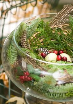 Holiday tip from Nell Hill: Decorating doesn't have to be elaborate. This tiny natural arrangement in a clear bowl reinforces the season in a big way. More photos from Nell Hill's home: http://www.midwestliving.com/homes/featured-homes/holiday-house-tour-at-home-with-nell-hills-owner/page/5/0