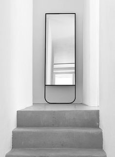 It's incredible what a simple mirror can add to a minimal and concrete architecture. #mirror #concrete #modern
