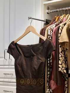 Valet Rod for a Boutique-Like Closet --> http://www.hgtv.com/bedrooms/how-to-make-your-walk-in-closet-resemble-a-chic-boutique/pictures/page-6.html?soc=pinterest