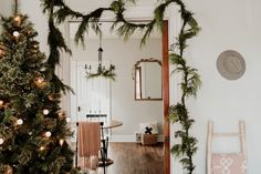 Holiday Home Tour: Elizabeth Hyland's Midwest Bungalow (The Everygirl) Merry Christmas Baby, Christmas Mood, Modern Christmas, Hygge Christmas, Cottage Christmas, Christmas Shopping, Xmas, Replace Light Fixture, Favorite Christmas Songs