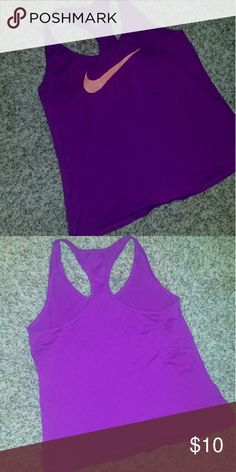 Nike Workout Tank Purple racerback style tank with orangish/peach check. Only worn 3 times. Good used condition. Nike Tops