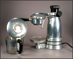 A fantastic looking vintage 40's or 50's electric (for North American voltage) espresso and cappuccino maker. Beautifully machined from aluminium, the design is spectacular: compact and graceful. I have tested it and it makes a great cup of cappuccino. The frothing wand is better than most modern machines I have used.