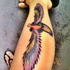 http://tattoomagz.com/gorgeous-wings-tattoos-on-legs/purple-lovely-wing-tattoo-on-leg/