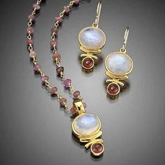 Shimmering genuine Rainbow Moonstone cabachons accented by fiery Rhodolite Garnets and set in 14k gold vermeil. Necklace is strung on a gorgeous genuine Pink Tourmaline wire-wrap adjustable chain. Designed and handmade in northern California by Sierra Sonoma Art Works. Comes with designer gift box.