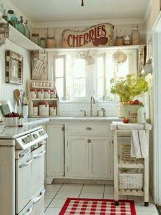 Small kitchen. Retro. :)  I like the shelf in the corner for better storage.