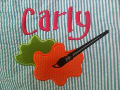 Here's a close-up of the art smock wit the paint splash appliques. I love orange, green and fuschia on aqua!
