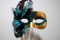 DIY these simple masquerade masks for Halloween—the colors, materials, and designs are endless!