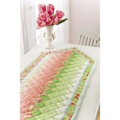 Colorwash Table Runner Pattern from Annie's -- Use your favorite jelly roll to make this fun Colorwash Table Runner Pattern! Mom this would be soo pretty for easter Table Runner And Placemats, Table Runner Pattern, Quilted Table Runners, Small Quilts, Mini Quilts, Braid Quilt, Place Mats Quilted, Quilted Table Toppers, Jellyroll Quilts