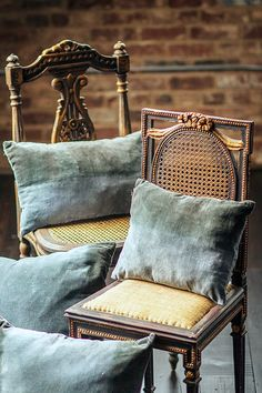 Love these cane chairs have designer pillows same as these in Scalamandre Duck Egg blue Silk Velvet