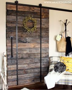 Make your own pallet wood barn door.
