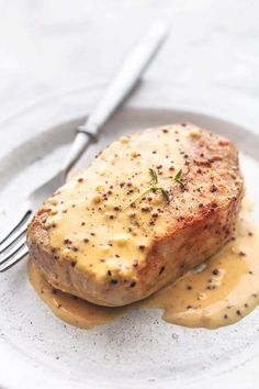 Pork Chops with Dijon Cream Sauce is a dreamy, delicious way to take plain old pork chops to a whole new level. These thick, juicy pork chops smothered in a garlicky dijon sauce will make you think twice about ever serving a plain old pork chop again! Healthy Pork Chops, Juicy Pork Chops, Boneless Pork Chops, Easy Crockpot Pork Chops, Dijon Cream Sauce, Sauce A La Creme, Mustard Cream Sauce, Pork Tenderloin Recipes, Pork Chops