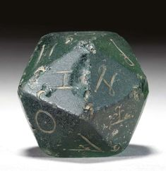 A Roman glass gaming die ,2nd century.   Romans rolled XXs.