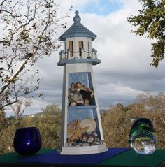 wooden light house with shells