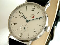 """Nomos Glashütte Tangente Gangreserve 35.0 mm Manual Date: Generally I admire but would not want to own a manual winding timepiece. This Nomos however, with the addition of their """"gangreserve"""", Is just too cool and too beautiful to be ignored."""