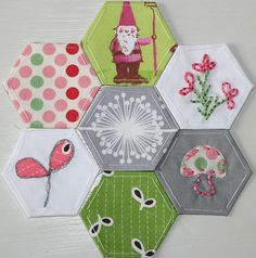Embroidered and appliqued hexagon...pretty