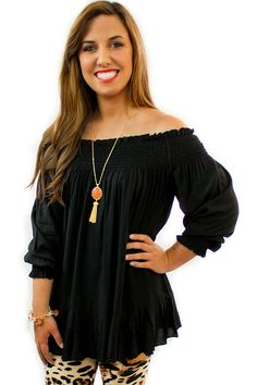 Off Shoulder Top - $36.95 - The Off Shoulder Top comes in two choices of color Black or Coral. Wear this off one or both shoulders is all depends how sassy you want to be.  | available at https://www.envyboutique.us/product/off-shoulder-top/ |  #Envy #Boutique #fashion #fashiontrends