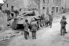 Knocked-out German Panther tank, destroyed by an infantry PIAT at Bretteville-en-Orguilleuse, 1944.  Photograph from an album compiled by Major W H J Sale, MC, 3/4 County of London Yeomanry (Sharpshooters), World War Two, North West Europe.