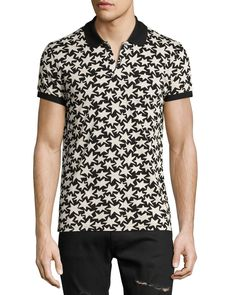 Saint Laurent polo shirt in allover star print. Solid spread collar; two-button placket. Short sleeves; ribbed cuffs. Pullover style. Slim fit. Cotton. Made in Italy.