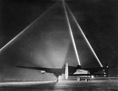 Avro Lancaster B Mark III, 'PM-M'An Avro Lancaster on the runway before taking off for an air raid, with searchlights indicating the height of the cloud base, of No. 103 Squadron RAF pauses on the flarepath at Elsham Wolds, Lincolnshire Ww2 Aircraft, Military Aircraft, Lancaster Bomber, The Blitz, Air Raid, Ww2 Planes, Royal Air Force, Cloud Based, World War Two