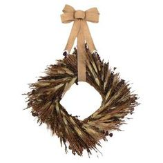 """Hanging from a burlap ribbon, this square wreath features wheat, Sudan grass, and eucalyptus.  Product: WreathConstruction Material: Twig, burlap and dried grassesColor: Brown and beigeDimensions: 17"""" H x 17"""" W (without ribbon)Note: Guaranteed delivery by HalloweenCleaning and Care: Wipe gently with a dry cloth. Avoid direct sunlight and humidity."""