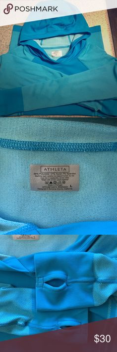 Athleta Neothermal Hoodie in Flash Blue size Large I am selling an Athleta Neothermal Hoodie in Flash Blue in a size Large. This hoodie is made of 'unstinkable' fabric and is seamless. The raglan material and thumb holes make this piece excellent for running and gym tracking. It is 'new without tags'. Athleta Sweaters