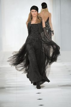 Fashion and home design all-star Ralph Lauren revamped the black dress with a gothic glam interpretation in his fall/winter ready-to-wear 2010/11 line. Shown here is the tulle Beaded Kendra. Dress and wool Elson Vest paired with black lace accessories. #Luxe #Fall 2010