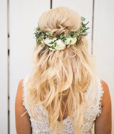Greenery crowns and loose curled locks have us falling in love with this boho-beautiful 'do!,half up half down wedding hair inspiration