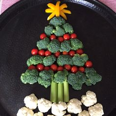 Celebrate Christmas in style with this cute Christmas tree shaped vegetable platter! Broccoli makes the green branches, red cherry tomatoes make the ornaments, cauliflower makes the white snow and the yellow bell pepper makes the bright star! What could be a more perfect appetizer for your Holiday party than a Christmas tree made entirely out of vegetables? Different color veggies make such a perfect copy of a Christmas tree that makes you go like 'Why didn't I think of that?' T...