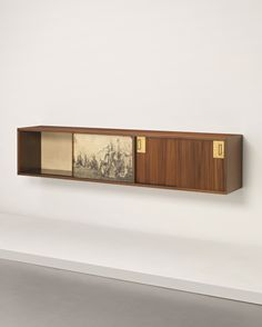Gio Ponti and Piero Fornasetti; Custom Walnut and Brass Cabinet for Ingegner Preti, 1948.