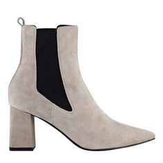 Mid ankle chelsea bootie designed with a modest covered flared heel.