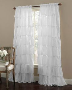 White ruffle curtains.. CUTE! but maybe too girly for us