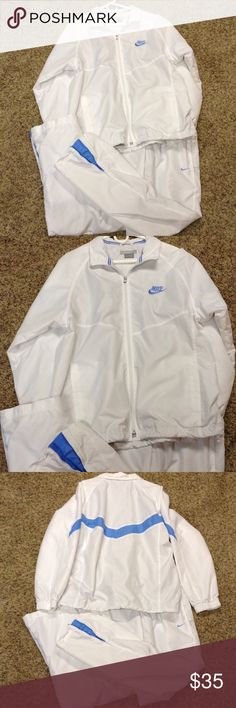 Nike sweat suit White and blue lined workout suit. No stains only worn a time or two. Super sharp suit Nike Other