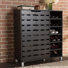 Enjoy the sleek and modern storage of this fantastic 2-door shoe cabinet. Constructed of engineered wood, this shoe cabinet is finished with dark brown faux wood grain veneer for practical daily use.