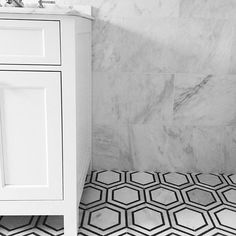 marble bathroom, hex tile, black and white tile, master bathroom, white vanity