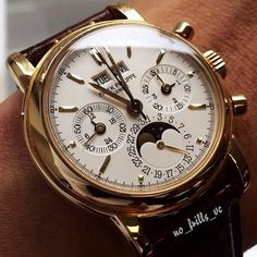 Patek Philippe. Gold perpetual moon face automatic chronograph