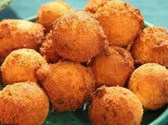 Homemade Southern Hush Puppies 1 1/2 cups yellow cornmeal 1 cup all-purpose flour 2 tbsp baking powder 1 tsp baking soda 3 tbsp sugar 1 tsp salt 1 tsp cayenne 3/4 cup buttermilk 1/2 cup milk 2 eggs 1 large yellow onion, finely chopped canola oil (for frying)