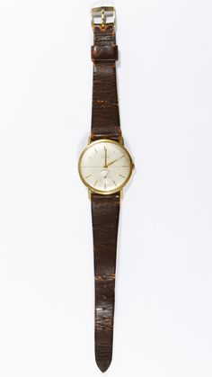 Lot 468: Lord 18k Gold Cased Wrist Watch; Having 17 jewel movement on a brown leather band; marked on back of case