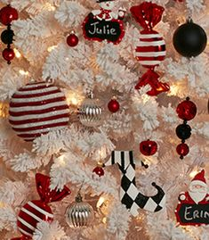 Going for a bold look this year? Black ornaments, oversized shapes, and traditional reds draw extra attention to a classic white tree. Black Christmas Trees, Diy Christmas Ornaments, Christmas Desserts, Christmas Time, Christmas Ideas, Christmas Bulbs, Christmas Decorations, Xmas, Holiday Style