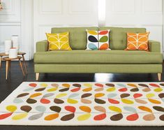 In 2009 the Orla Kiely at Heal's range of furniture was launched. Distinct designs of colour and pattern dominate Orla Kiely's work. The Mistral sofa, multi stem rug and Ercol nest of tables are all featured in this lifestyle. Contemporary Rugs, Contemporary Furniture, Living Room Sofa, Home Living Room, Porches, Style Lounge, Retro Furniture, Lewis Furniture, Furniture Ideas