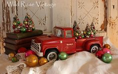Now the old red truck can haul vintage bottle brush trees!... or ornament... or any kind of nicknacks... spring time.. maybe a bird nest??? oh the ideas...