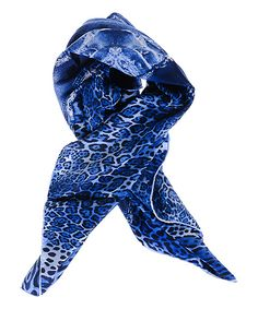 Versace 19V69 Blue Leopard & Denim Scarf | zulily -  $34.99 $140.00 Product Description:  A bold blend of casual denim and vivacious leopard define this scarf with statement-making style. The versatile length allows it to be worn in various ways from a head scarf to a basic loop.      35.4'' x 35.4''     100% polyester     Machine wash     Imported