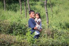 Father and daughter in rural North Korea.