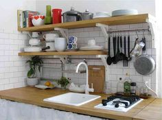 small kitchen - shelves above sink