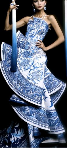 This striking and beautifully detailed dress by Guo Pei would be perfect for a blue and white china themed wedding.